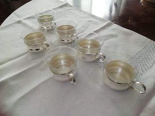 Juego café cristal con elegante soporte metálico