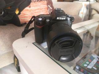 Cámara Nikon D90 + objetivo + trípode