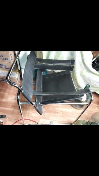 elegante sillón amplio cromado
