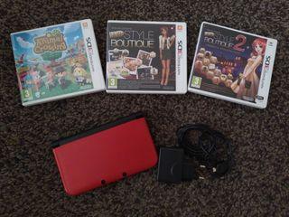 Nintendo 3DS roja y dos videojuegos 3DS