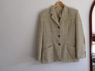 Blazer color crema Talla 36.