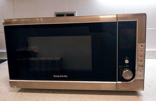 Microondas semi-nuevo Taurus 100w