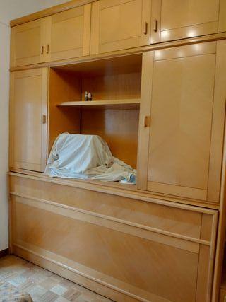 Muebles modulares en L, con cama libro.