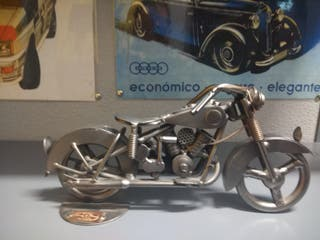 moto de adorno