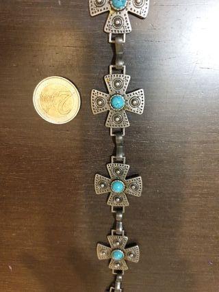 colgante cruces. cinturón