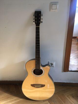 Guitarra acústica, afinador y libro