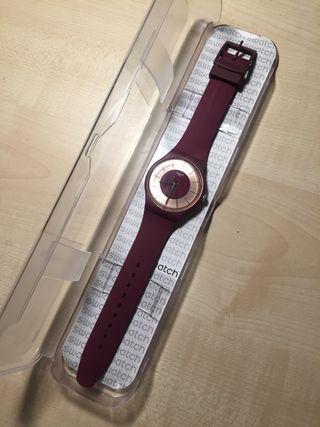 Reloj swatch.