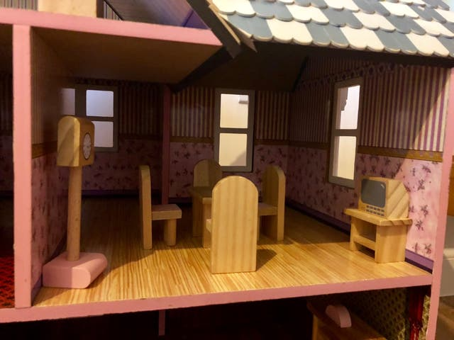 Wooden dolls house with wooden furniture