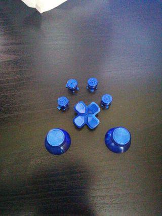 Botones metálicos azules mando PS4