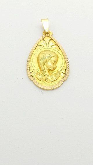 Medalla Virgen Niña oro 18kts. 5,70 grms.