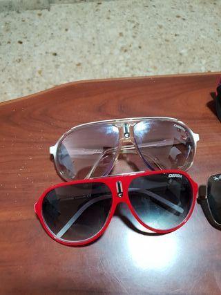 2 gafas de sol carrera y unas ray-ban