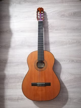 Full size acoustic guitar with accessories