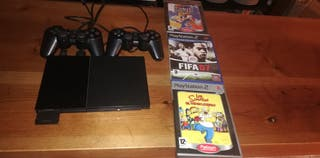 playstation2 + 2 mandos + 3 juegos.