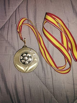 medalla oro para perro