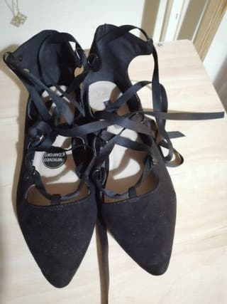 Worn Black Ballerinas With Ribbons Size 6