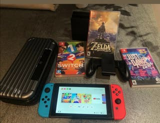 Nintendo Switch console with three games and case