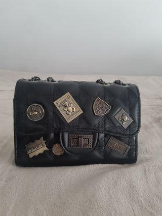 bolsa con detalles brocados nueva