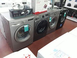 Lavadora color acero 8 kg nueva .