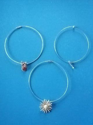 3 colgantes de plata y 3 collares rígidos de plata