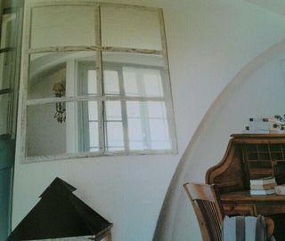 Espejo de madera antiguo restaurado