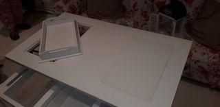 mesa blanca de centro elevable