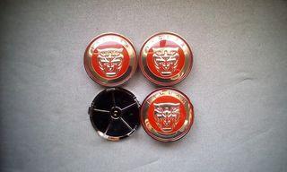 4 Tapabujes centro de ruedas Jaguar rojo 68mm.