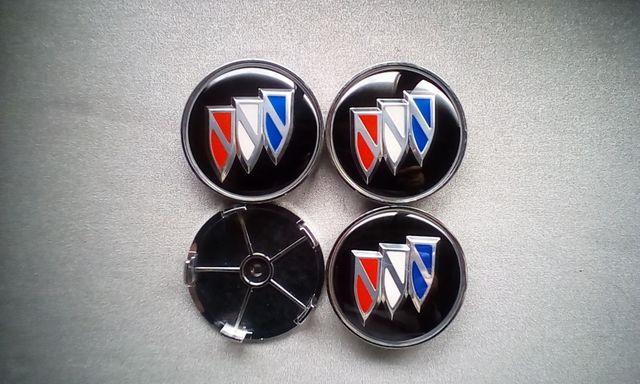 4 Tapabujes centro de ruedas Buick color 68mm.
