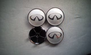 4 Tapabujes centro rueda Infiniti plata gris 68mm.