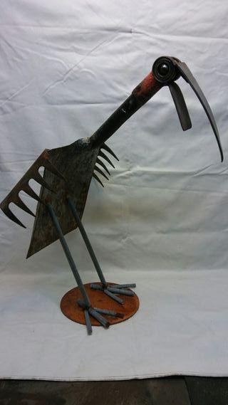 Escultura pajaro