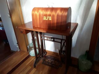 vendo maquina de coser antigua alfa