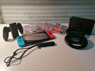 Nintendo Switch + accesorios + juegos.