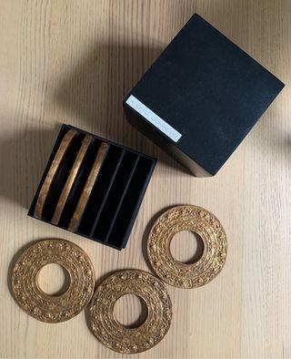 Posavasos de madera de Adolfo Dominguez