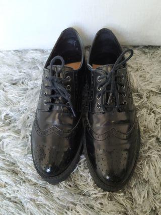 Zapatos planos de charol