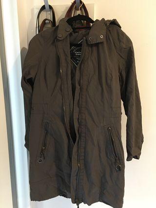Greyish-brown hooded knee-length parka