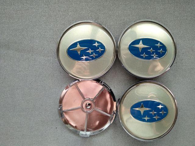 Tapabujes centro rueda Subaru plata azul 68mm.