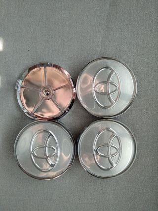 4 Tapabujes centro rueda Toyota plata plata 68mm.