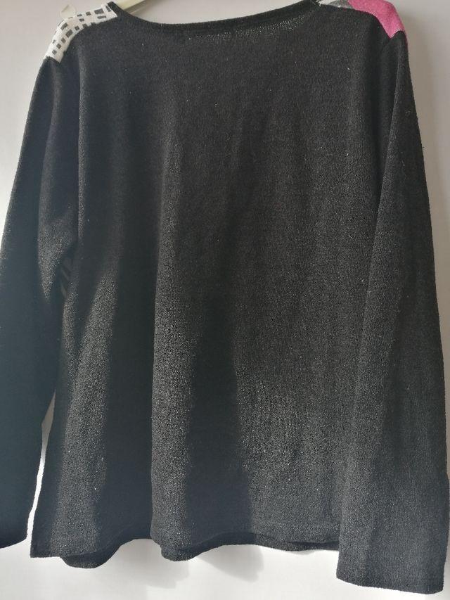 Suéter negro.TL/XL