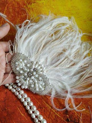 Tocado de pluma ,perla y cristal peineta novia