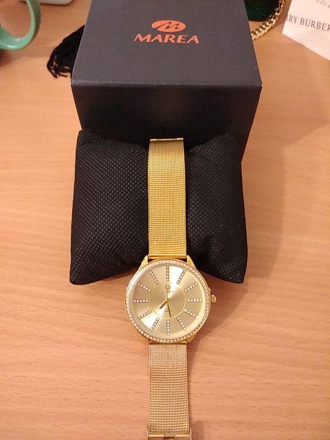Reloj dorado Marea