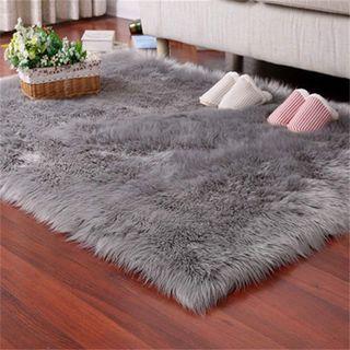 alfombra gris nueva 60x90cm