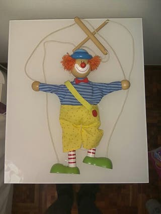 Juguete de marioneta de payaso.