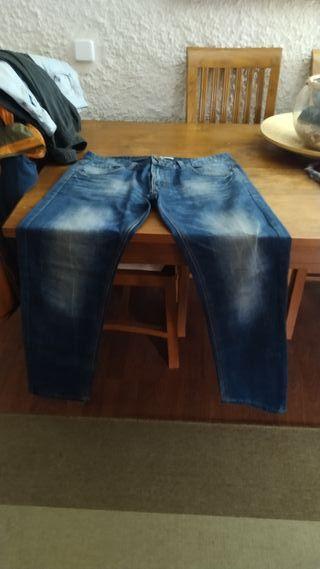 Pack 4 pantalones talla 48.