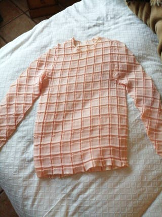 blusa plisada y sudadera