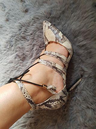 Zapatos serpiente de la tienda Charol