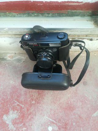 cámara de fotos antigua y monedas