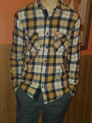 Camisa .