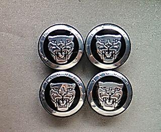 Tapabujes centro de ruedas Jaguar Negro 58mm.