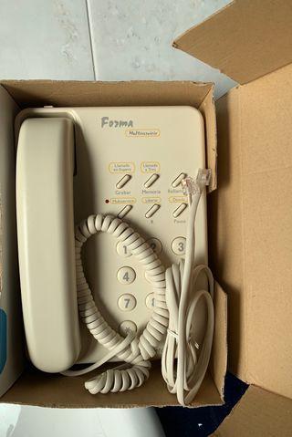 Teléfono fijo color crema,clásico