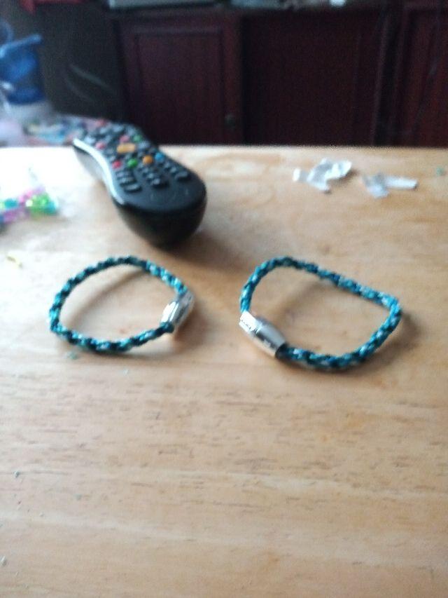 2 own made bracelets