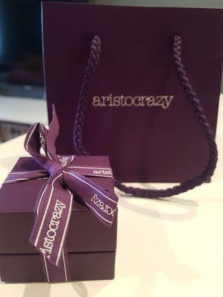 Bolsa, caja y Tummy Aristocrazy